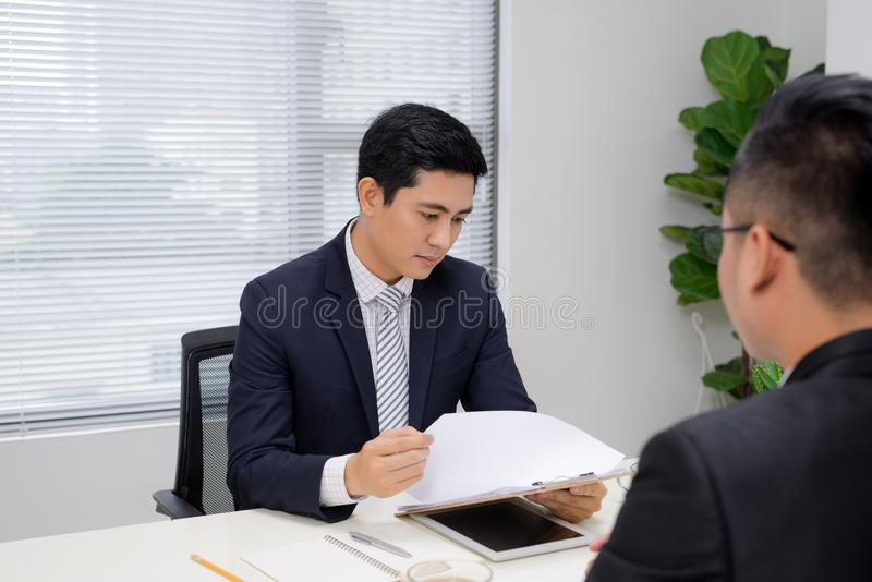 Job interview of two business professionals. Greeting new colleague stock photo