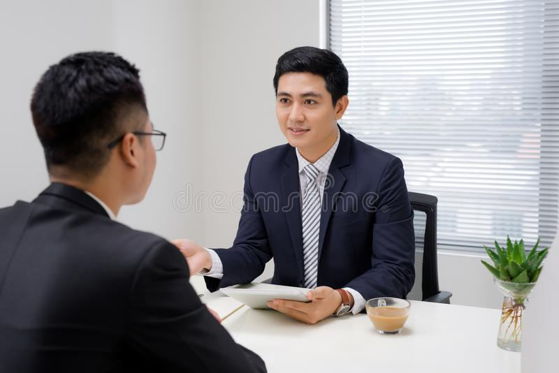 Job interview of two business professionals. Greeting new colleague royalty free stock image