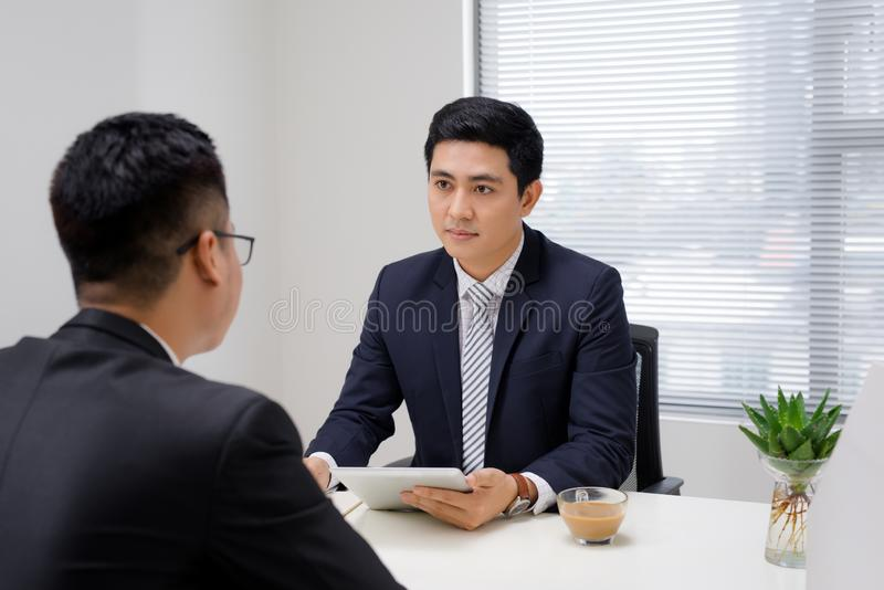 Job interview of two business professionals. Greeting new colleague.  royalty free stock photography