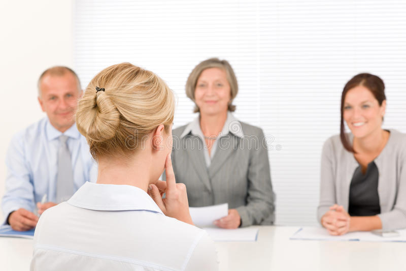 Job interview young woman with business team royalty free stock photography