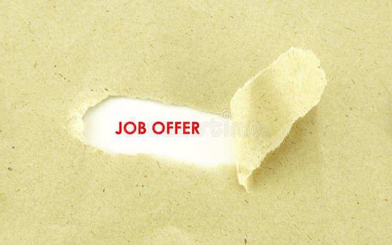 JOB OFFER. Text JOB OFFER appearing behind torn light brown envelope stock images