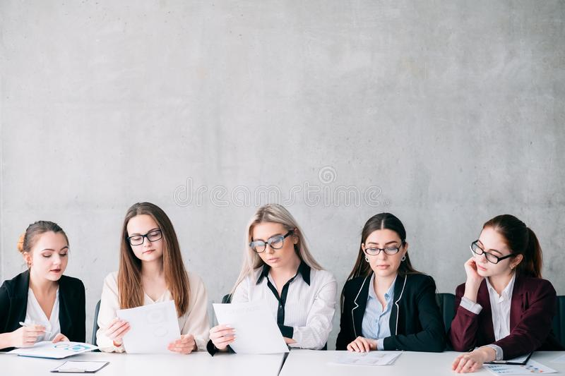Job opening corporate committee team copy space. Job opening. Corporate committee. Recruitment team selecting employees. Copy space on grey background royalty free stock photo