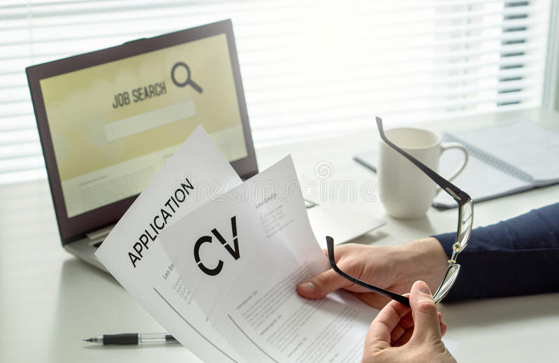 Job seeker in home office. Motivated applicant. Modern job hunting, seeking and employment. Man reading his cv or curriculum vitae. And job application paper stock images