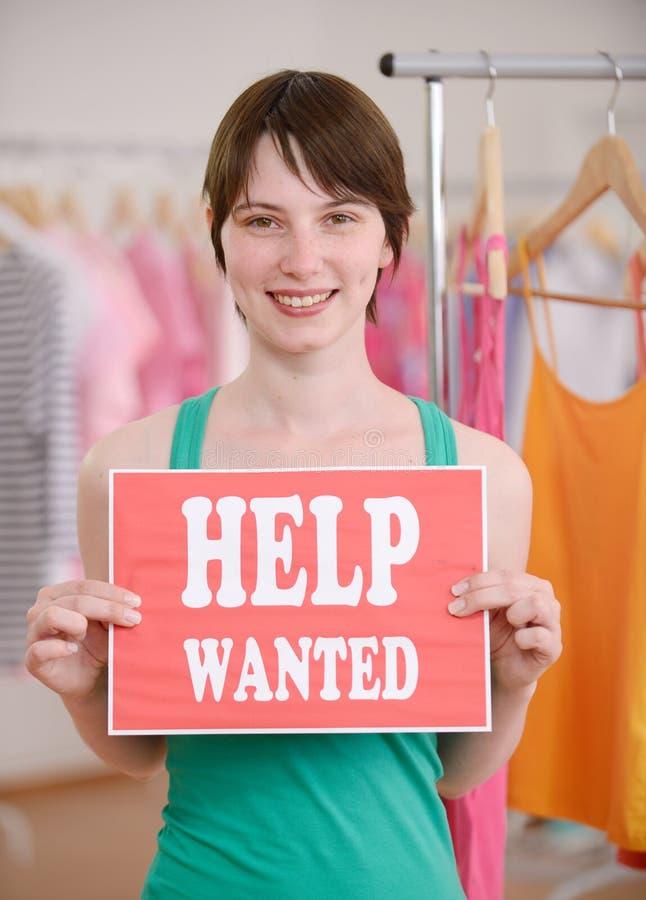 Jobangebot: Frau mithilfe wünschte Zeichen stockbild