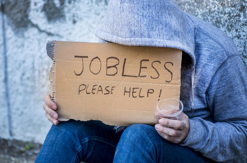 Jobless man begging on a street stock photography