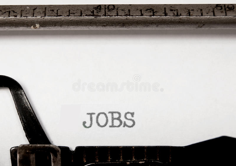 Jobs. The title jobs written on a vintage typewriter royalty free stock photo
