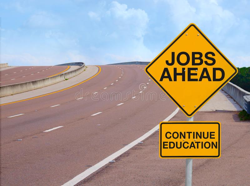 JOBS AHEAD CONTINUE EDUCATION road sign positive message of success stock images