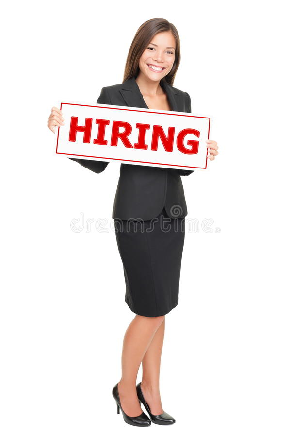 Jobs - businesswoman hiring. Hiring job woman holding hiring sign. Young attractive smiling Caucasian / Asian businesswoman isolated on white background