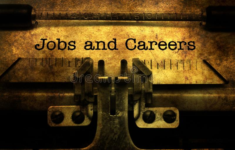 Jobs and careers text on typewriter. Grunge concept royalty free stock photo