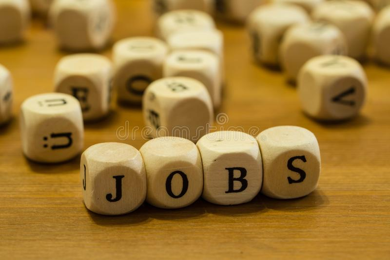 Jobs written with wooden cubes royalty free stock photography