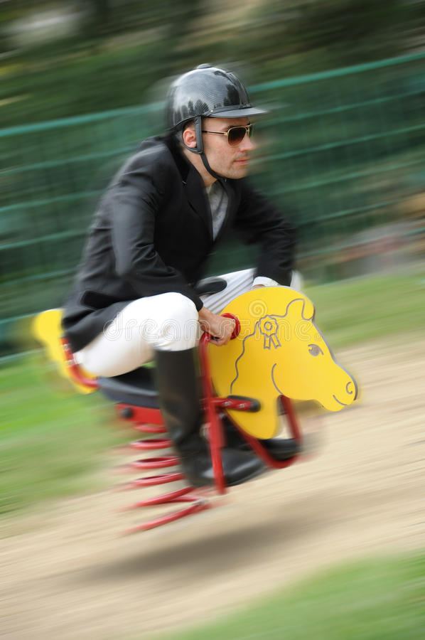 Jockey. Funny jockey with wooden horse stock photos