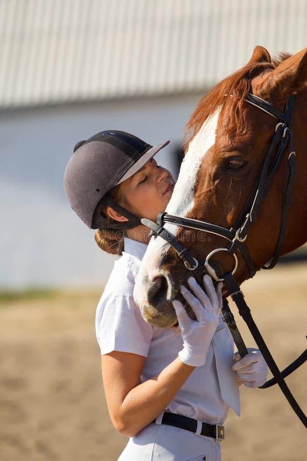 Jockey with purebred horse. Image of female jockey with purebred horse outdoors stock images