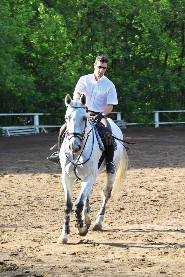Jockey Riding Horse Stock Photo
