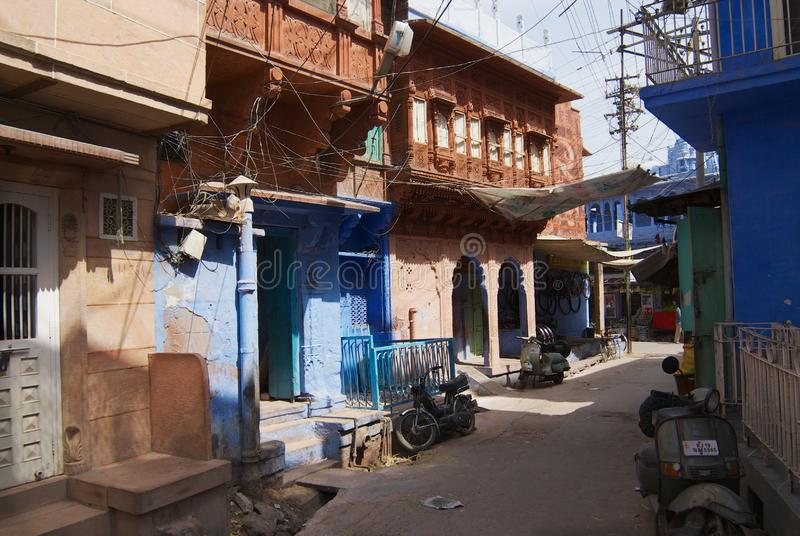 View to the historical traditionally blue painted old residential area buildings in Jodhpur, India. Jodhpur, India - April 06, 2007: View to the historical stock photos