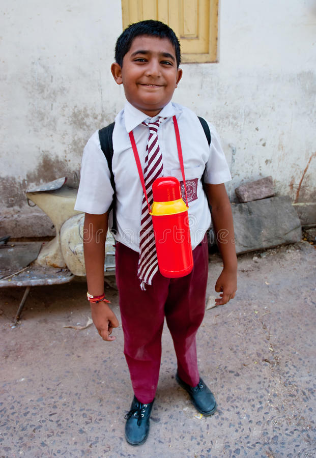 JODHPUR/ INDIA - SEPTEMBER 20, 2013: Cute schoolboy looking at t. He camera with interest on September 20, 2013 in Jodhpur, India royalty free stock photography