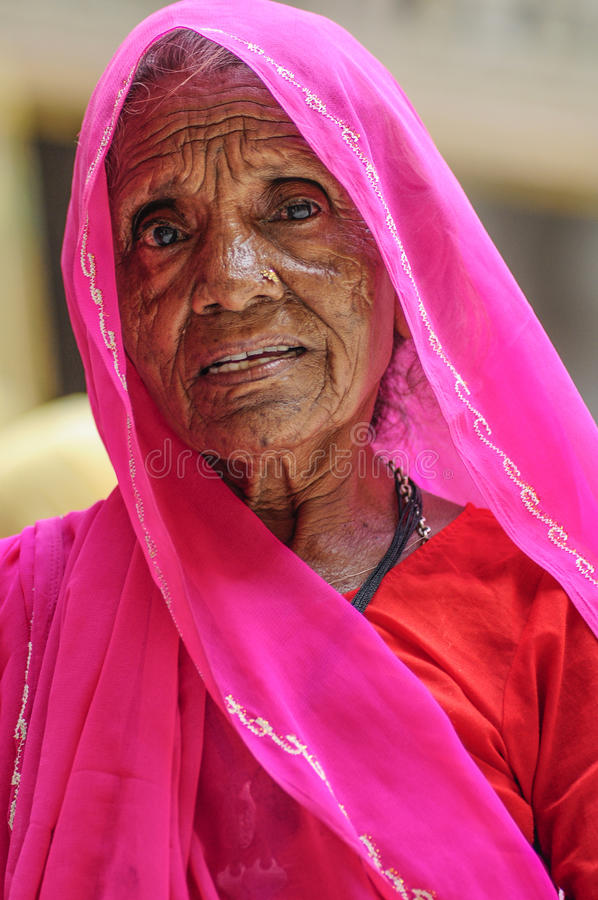 Jodhpur, India, september 10, 2010: Old indian woman face in pink sari. Jodhpur, India, september 10, 2010: Old indian woman face in pink sari stock image
