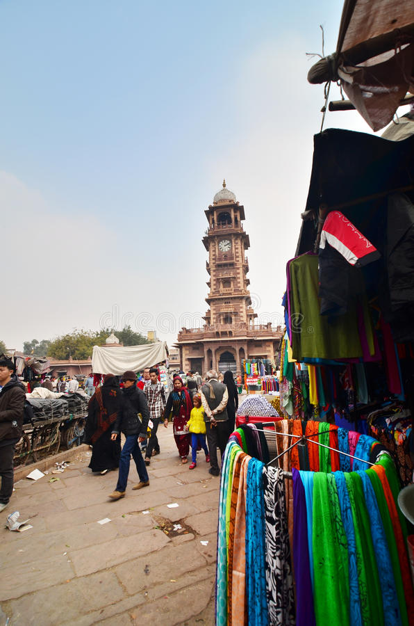 Jodphur, India - January 1, 2015: Unidentified people shopping at market under the clock tower in jodhpur royalty free stock image