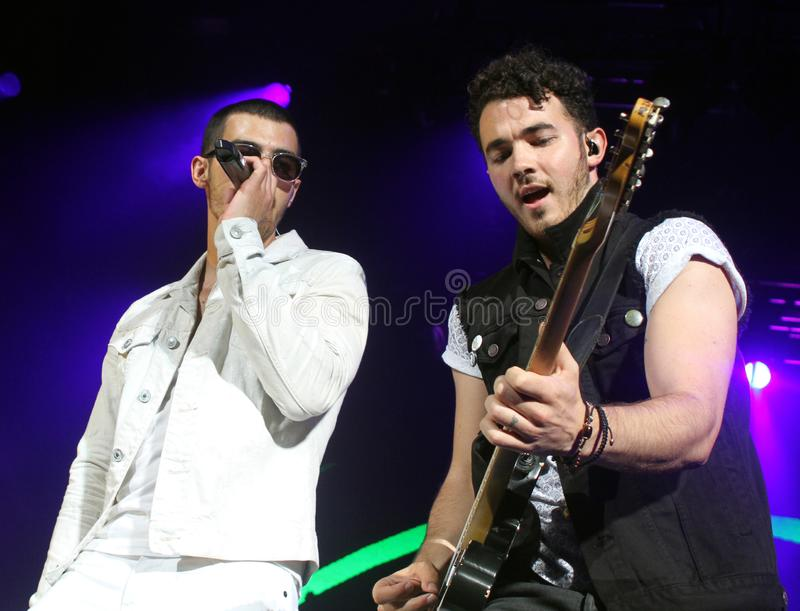 The Jonas Brothers perform in Concert. Joe Jonas L and Kevin Jonas with The Jonas Brothers perform at the Cruzan Amphitheatre in West Palm Beach, Florida on stock photos