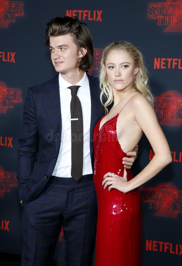 Joe Keery and Maika Monroe. At the Netflix`s season 2 premiere of `Stranger Things` held at the Regency Village Theatre in Westwood, USA on October 26, 2017 stock photography