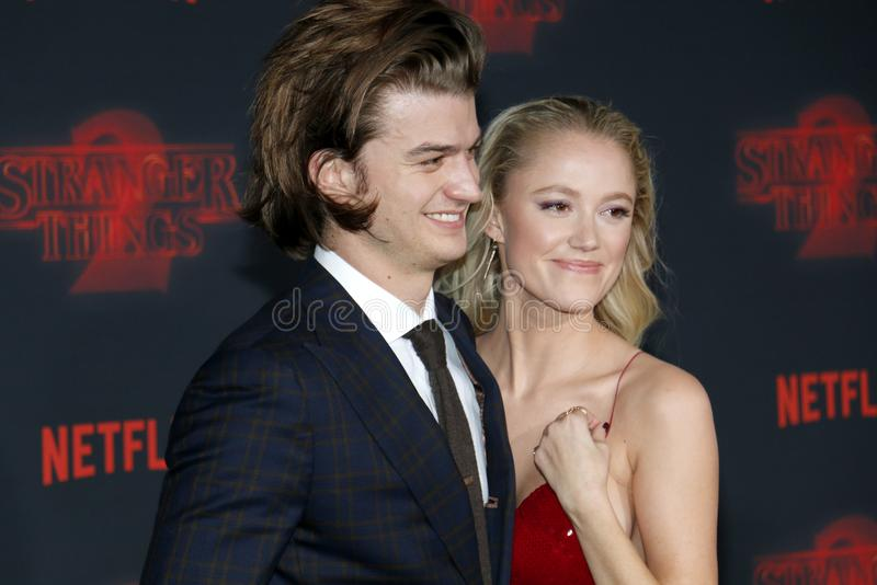 Joe Keery and Maika Monroe. At the Netflix`s season 2 premiere of `Stranger Things` held at the Regency Village Theatre in Westwood, USA on October 26, 2017 royalty free stock image