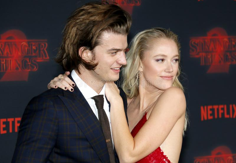 Joe Keery and Maika Monroe. At the Netflix`s season 2 premiere of `Stranger Things` held at the Regency Village Theatre in Westwood, USA on October 26, 2017 royalty free stock photos