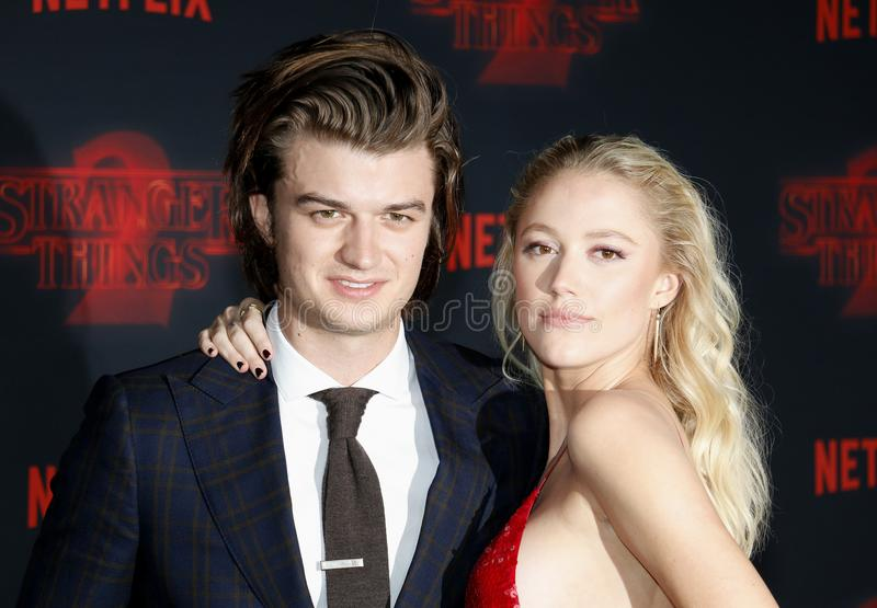 Joe Keery and Maika Monroe. At the Netflix`s season 2 premiere of `Stranger Things` held at the Regency Village Theatre in Westwood, USA on October 26, 2017 stock images