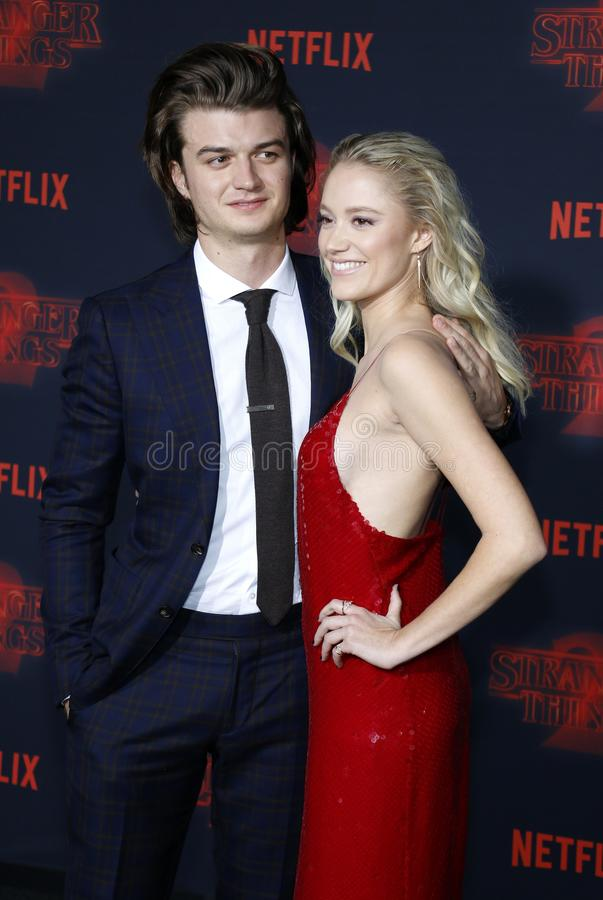 Joe Keery and Maika Monroe. At the Netflix`s season 2 premiere of `Stranger Things` held at the Regency Village Theatre in Westwood, USA on October 26, 2017 stock photo
