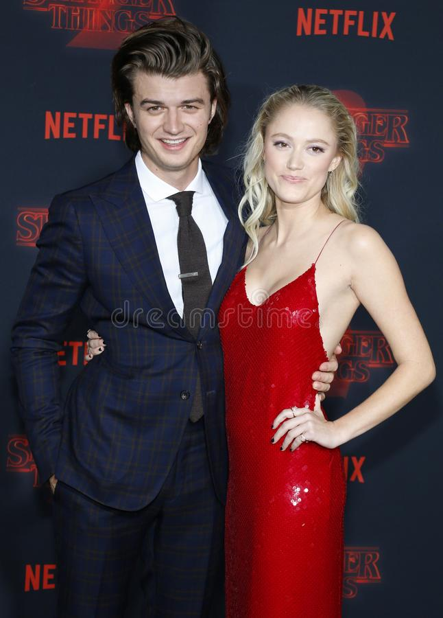 Joe Keery and Maika Monroe. At the Netflix`s season 2 premiere of `Stranger Things` held at the Regency Village Theatre in Westwood, USA on October 26, 2017 stock photos
