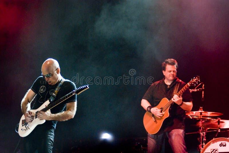 Joe Satriani de concert photo stock