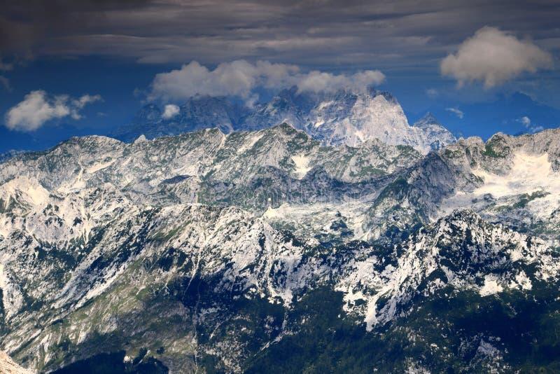 Jof di Montasio and Jof Fuart peaks, Julian Alps, Italy. Cloud covered Jof di Montasio Montaz and Jof Fuart Vis, the peaks of the Italian part of Julian Alps royalty free stock images