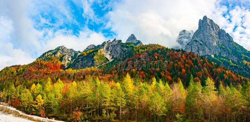 Jof di Montasio and Val Dogna in autumn. Panoramic view of Jof di Montasio in autumnal colors in Julian Alps, Val Dogna, Friuli Venezia Giulia, Italy royalty free stock photography