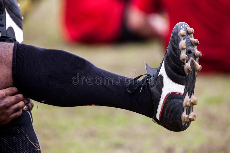 Jogador amador do rugby a aquecer-se foto de stock