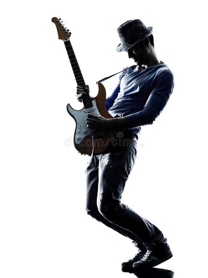 Jogador bonde do guitarrista do homem que joga a silhueta imagens de stock royalty free