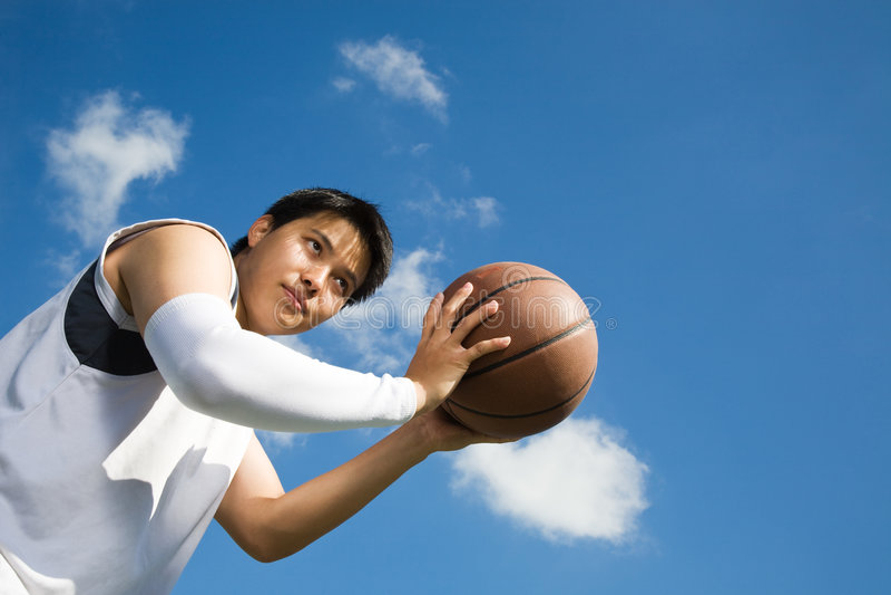 Jogador de basquetebol asiático fotografia de stock royalty free