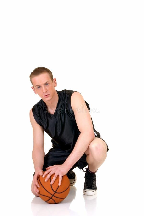 Jogador de basquetebol masculino novo fotografia de stock royalty free