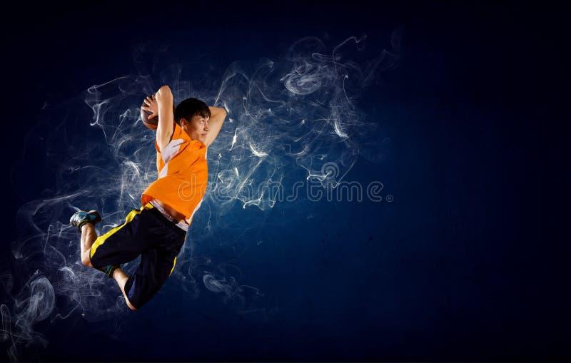 Jogador de basquetebol no fogo imagem de stock royalty free