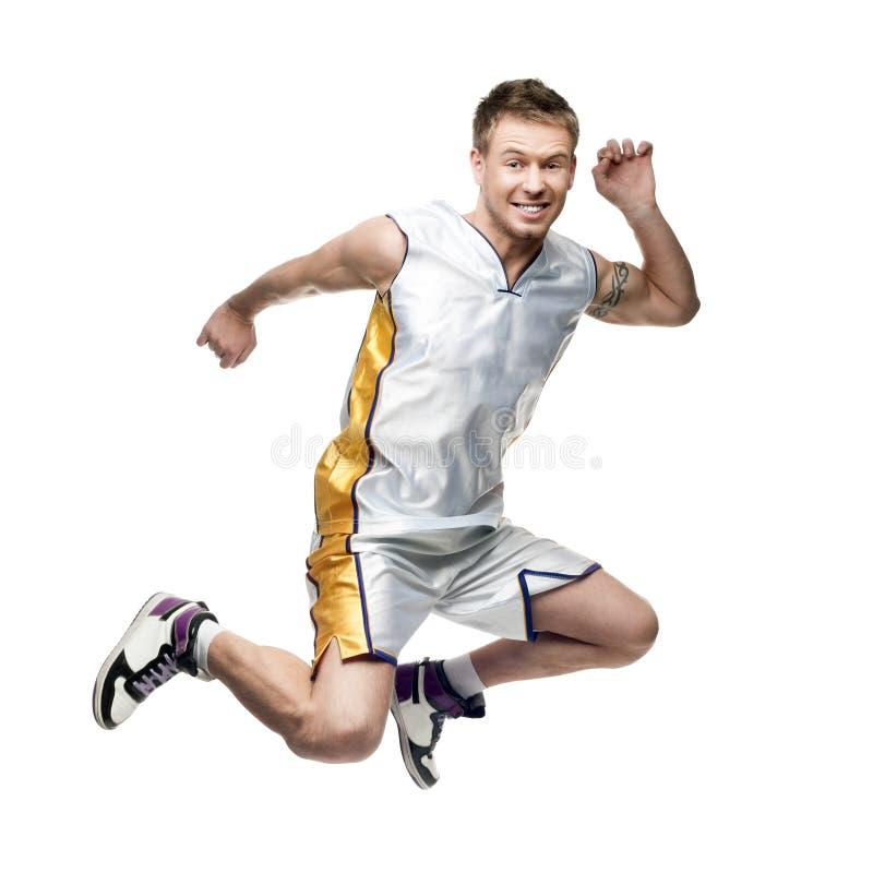 Jogador de basquetebol novo agressivo foto de stock royalty free