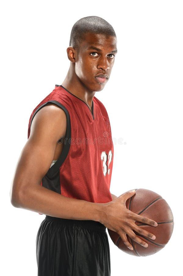 Jogador de basquetebol que guardara a bola fotos de stock