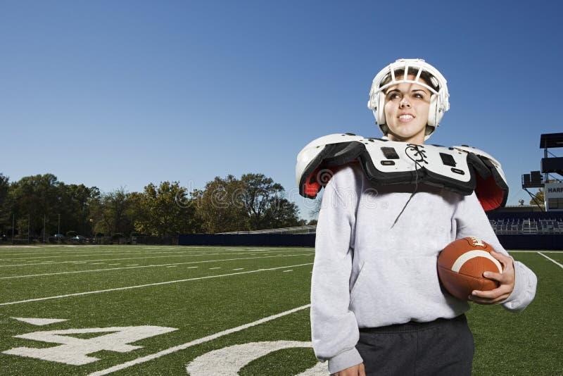 Jogador de futebol americano fêmea foto de stock royalty free
