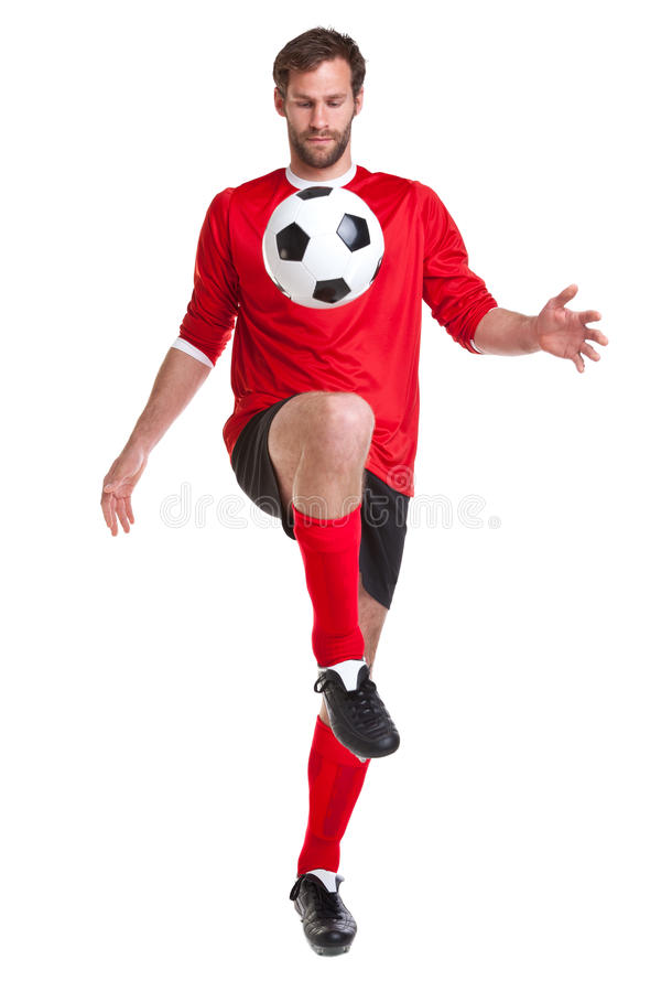 Jogador de futebol cortado no branco foto de stock royalty free
