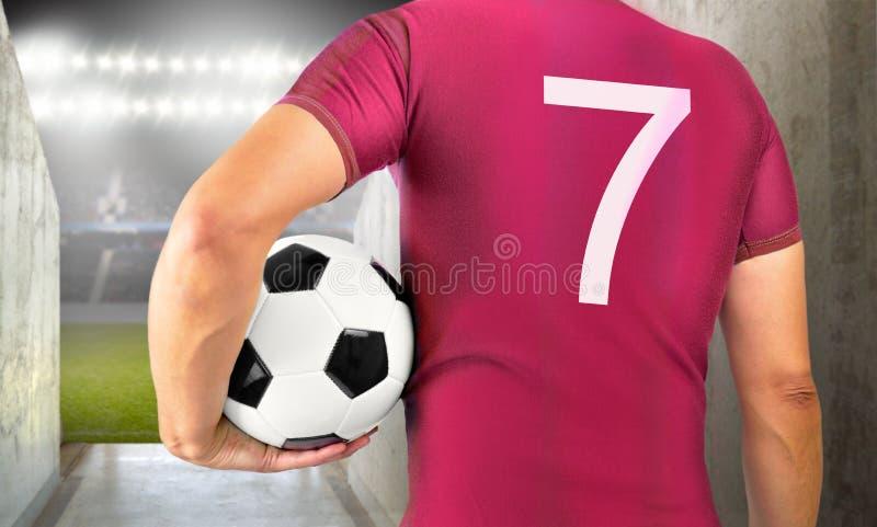 Jogador de futebol do futebol na equipe vermelha fotos de stock royalty free