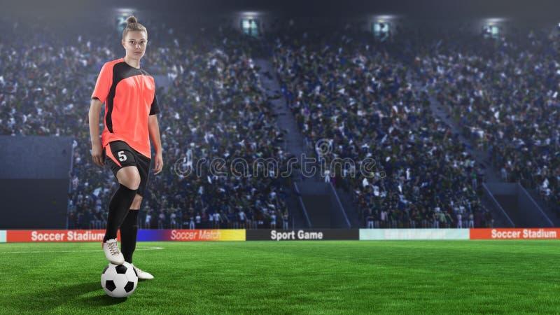 Jogador de futebol fêmea no uniforme vermelho no campo de futebol fotografia de stock royalty free