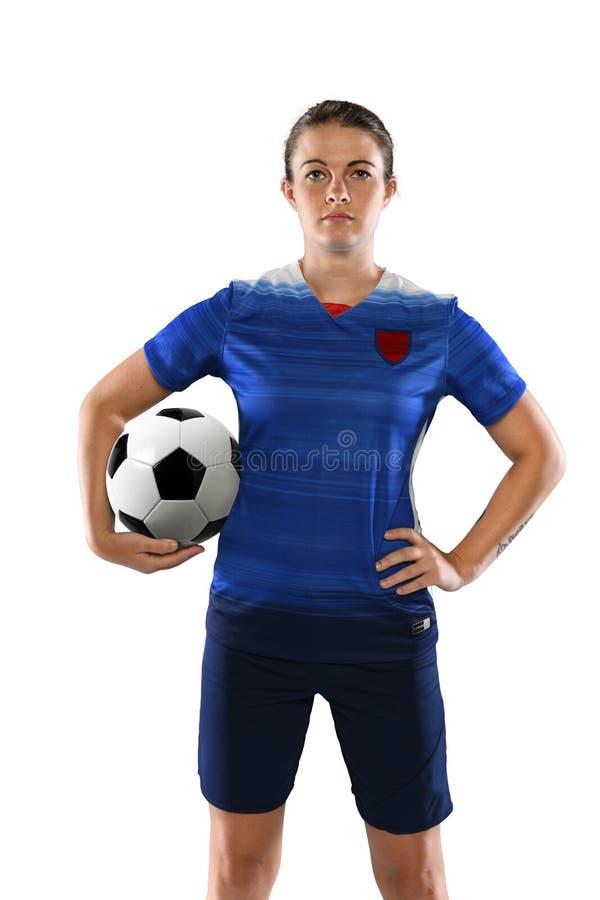 Jogador de futebol fêmea que guarda a bola fotografia de stock