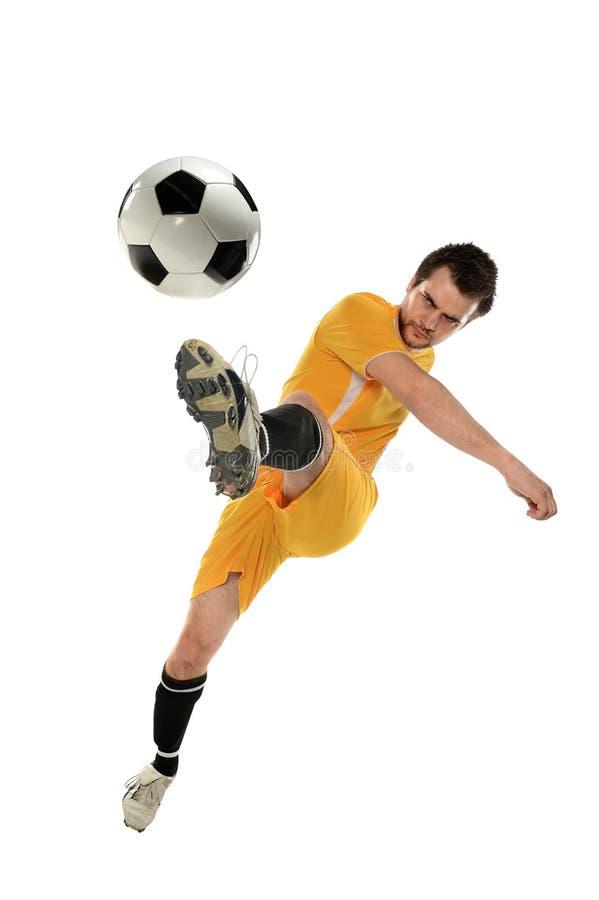 Jogador de futebol na ação fotografia de stock