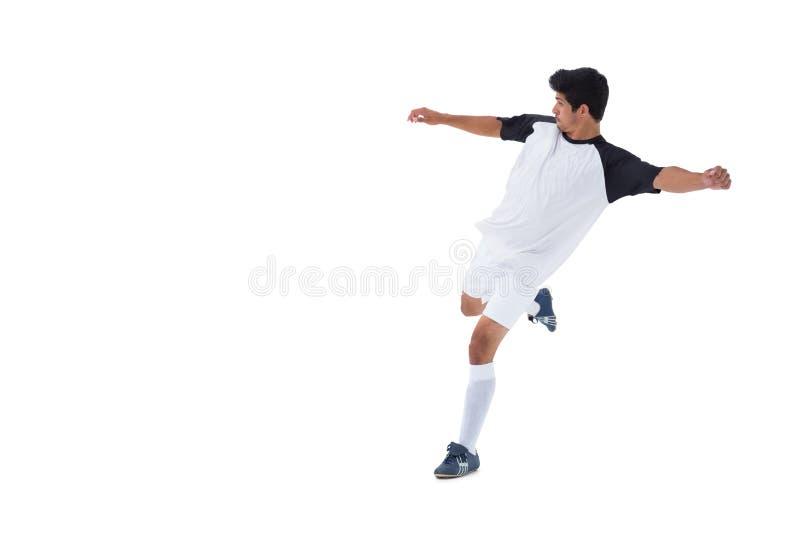 Jogador de futebol no retrocesso branco fotos de stock