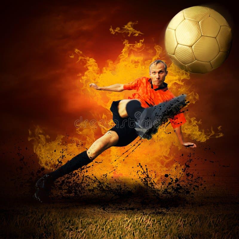 Jogador de futebol nos incêndios imagem de stock