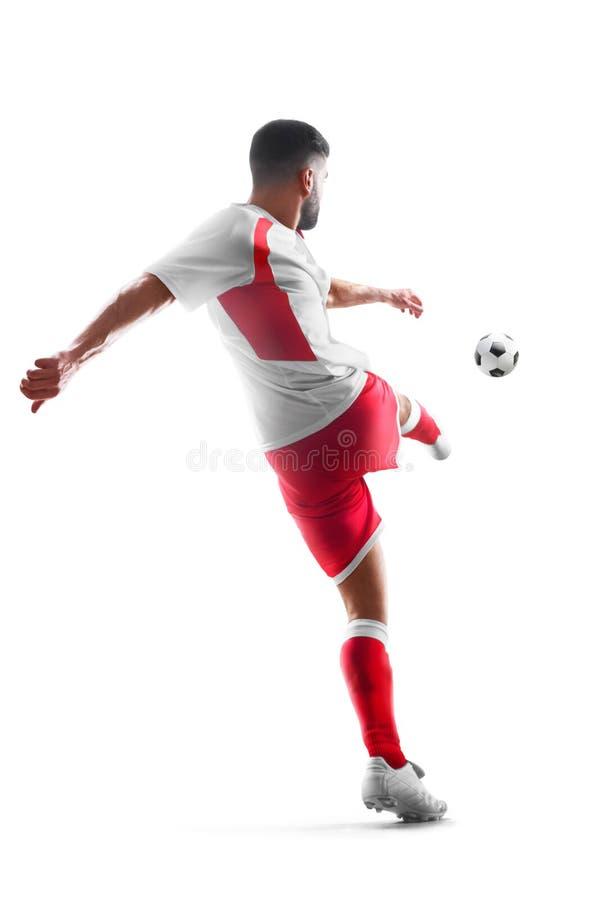 Jogador de futebol profissional na ação Vista traseira Isolado no fundo branco fotos de stock royalty free