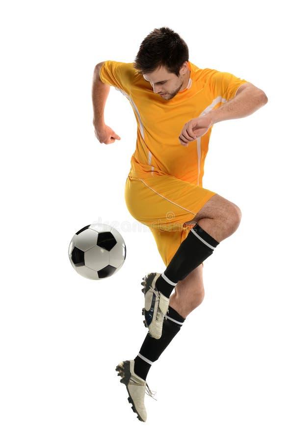 Jogador de futebol que executa o pontapé traseiro imagem de stock royalty free