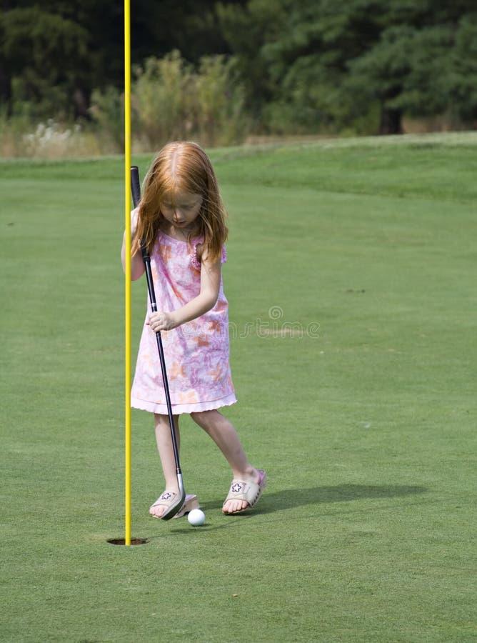 Jogador de golfe da menina foto de stock