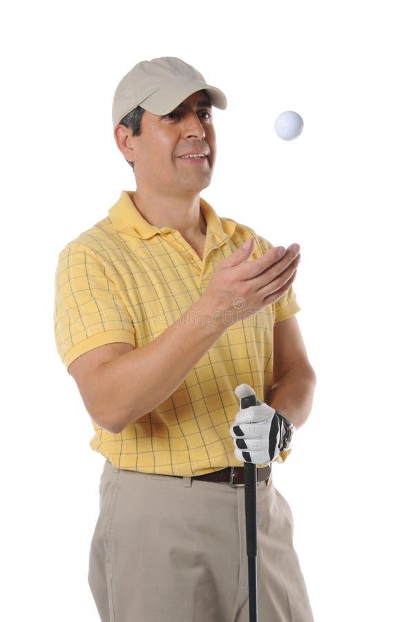 Jogador de golfe que lanç uma esfera foto de stock